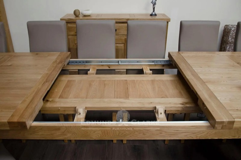 Melford Solid Oak 2400 Extending Dining Table showing 2 x 50cm leaves in storage DLX2400EXT