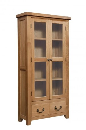 Somerset Oak Display Cabinet. Contemporary chunky oak with wax feel. 2 glass doors and 2 handy drawers. 3 shelves inside. Combination of antique brass drop down handles and knobs SOM087