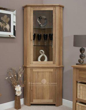 Bury Solid Oak Corner Display Unit. Adjustable glass shelves and cupboard underneath, chrome handles or oak bar handles available as optional extra