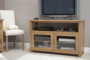 Bury solid oak entertainment unit. chrome handles fitted as standard. oak bar handles available as optional extra. bevelled glass doors with fixed shelf and opening for extra media items