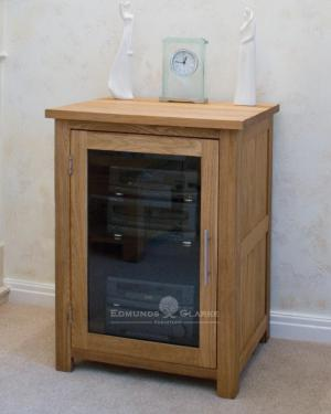 Bury Solid Oak HiFi Unit, adjustable glass shelves and bevelled glass door. chrome handle as standard, oak handle available extra optional