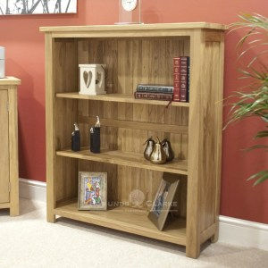 Bury small oak bookcase. 2 adjustable shelves. square feet perfect for small areas