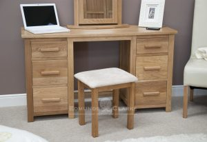 Bury Solid Oak large dressing table. with matching stool inclused with cream upholstered pad and six drawers