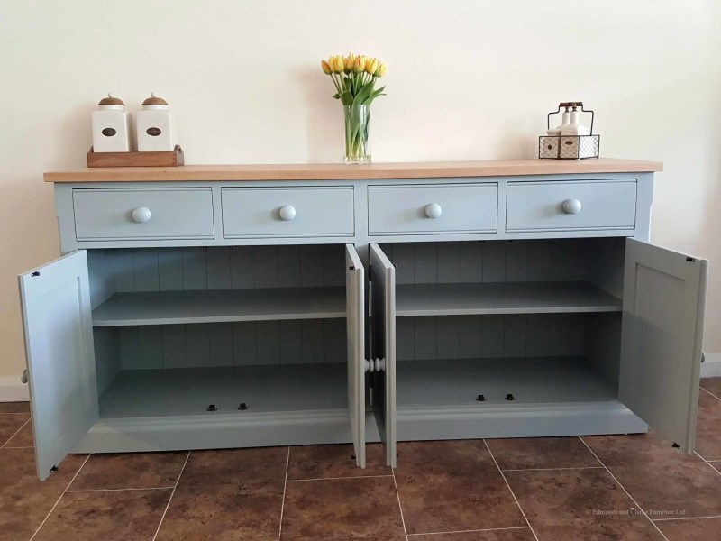 Edmunds 6'6 Painted Sideboard. 4 doors and 4 drawers. square edge oak top. adjusable shelves with painted round knobs. choice of handles. Image showing doors open.EDM031
