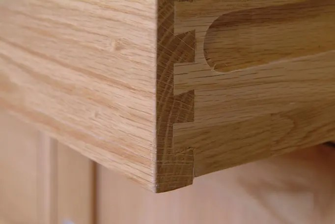 image showing dove tail drawer detail on Norwich Oak by edmunds & clarke furniture