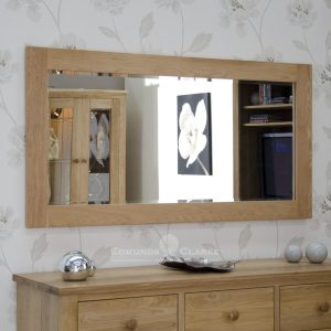 solid oak wall mirror 115cm x 75cm. bevelled glass in chunky oak frame