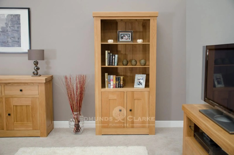 Hadleigh solid oak chunky 2 door bookcasewith adjustable shelves in a light oak finish and rustic handles