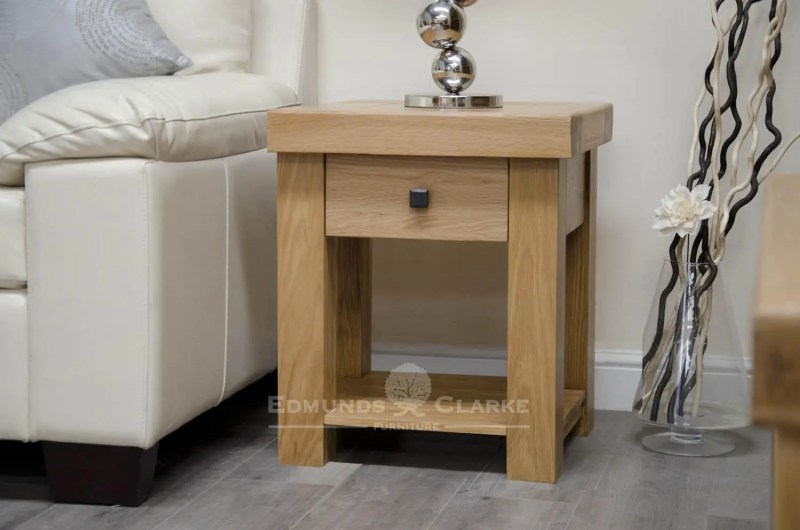 hadleigh solid oak lamp table with drawer. Light lacquered chunky oak with shelf under and black rustic square knob