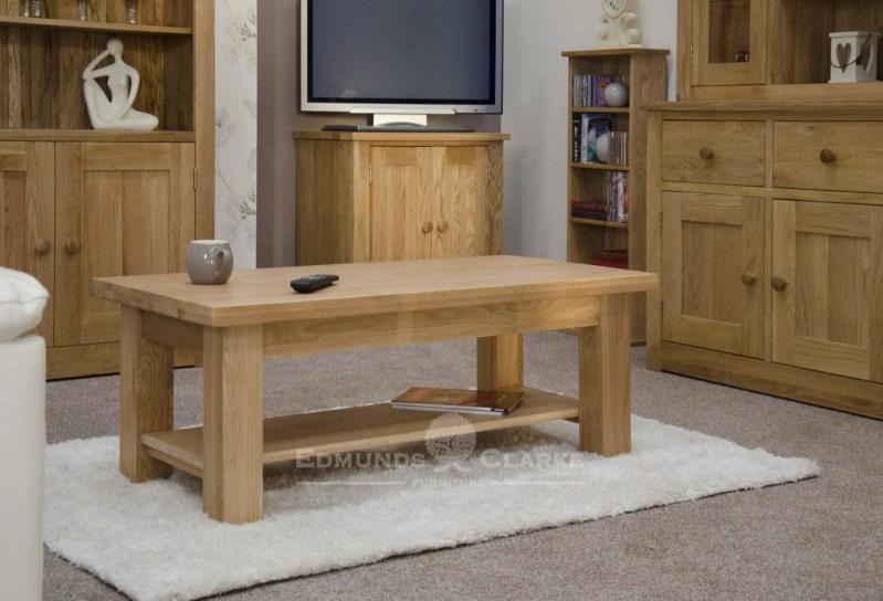 solid oak chunky square leg coffee table with magazine shelf 4 feet by 2 feet