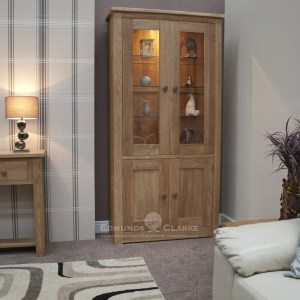 solid oak glazed 2 door cabinet with two panelled doors below