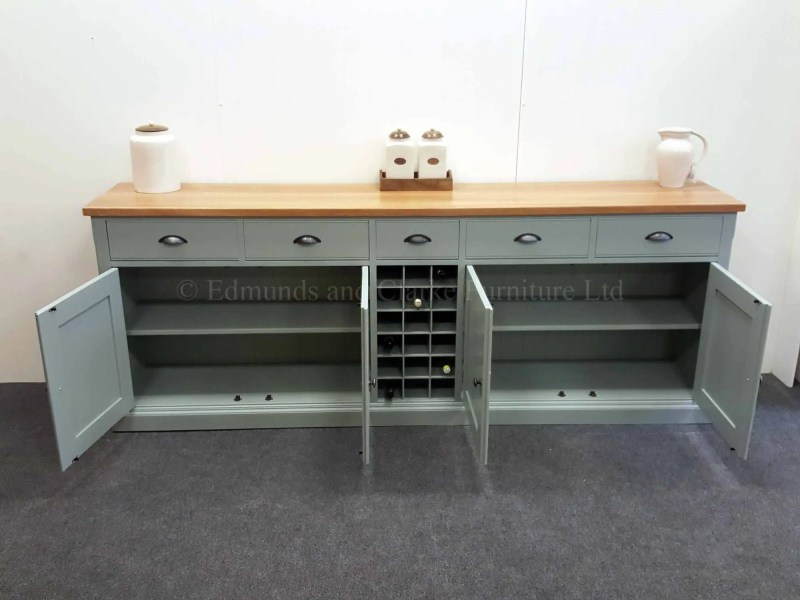 7ft painted sideboard with central 18 bottle wine rack two door and drawers either side