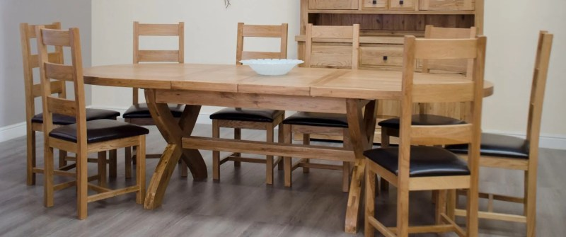 Melford solid oak cross leg oval extending table with two leaves