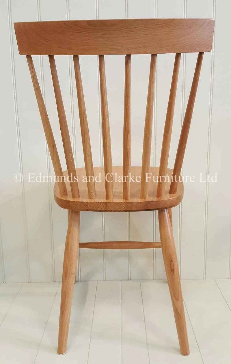 Oak Nordic dining chair made from solid oak turned legs and back rest