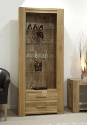 Solid oak tall two drawer display unit with glass shelves