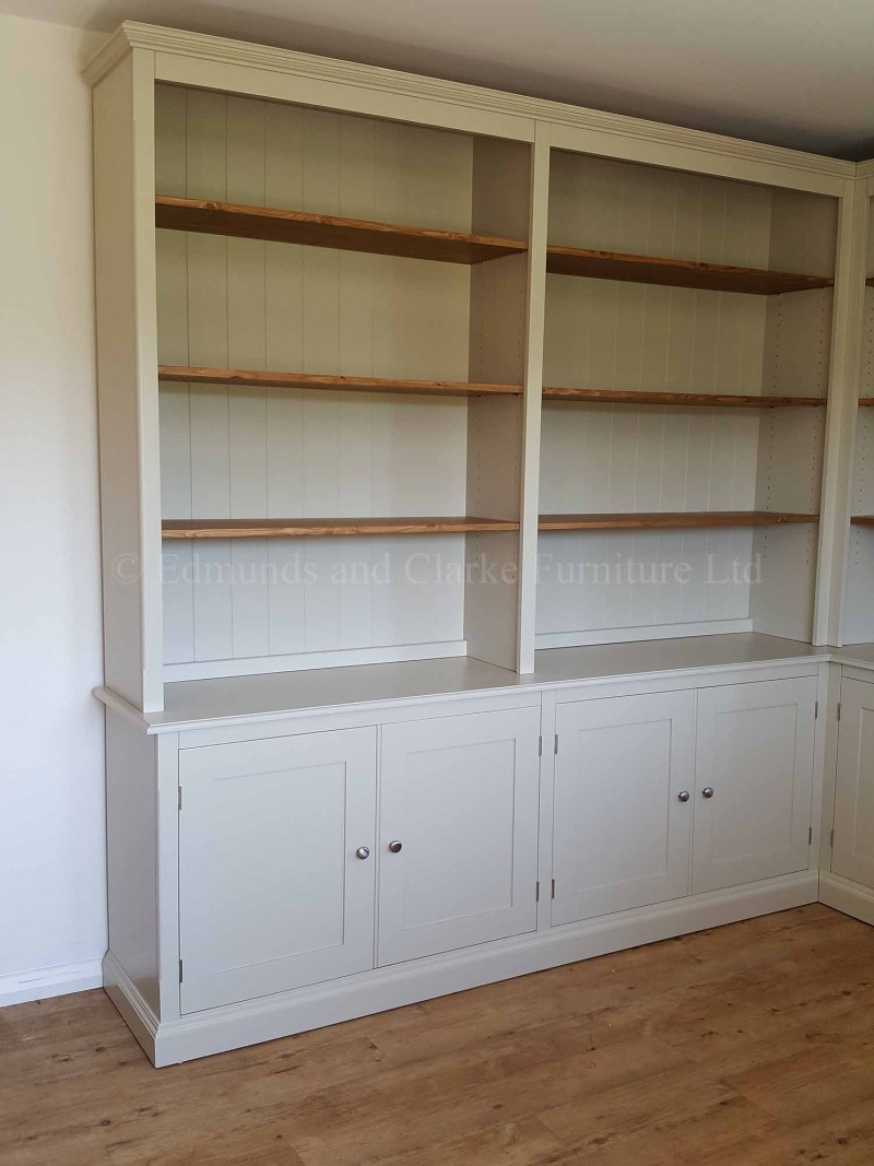 Library bookcase made to measure to fit a corner, painted with wooden adjustable shelves