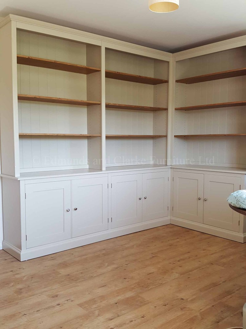 Corner painted bookcase open shelving with cupboards below