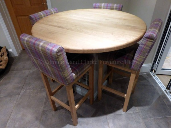 Round made to measure kitchen island with central wine rack pedestal