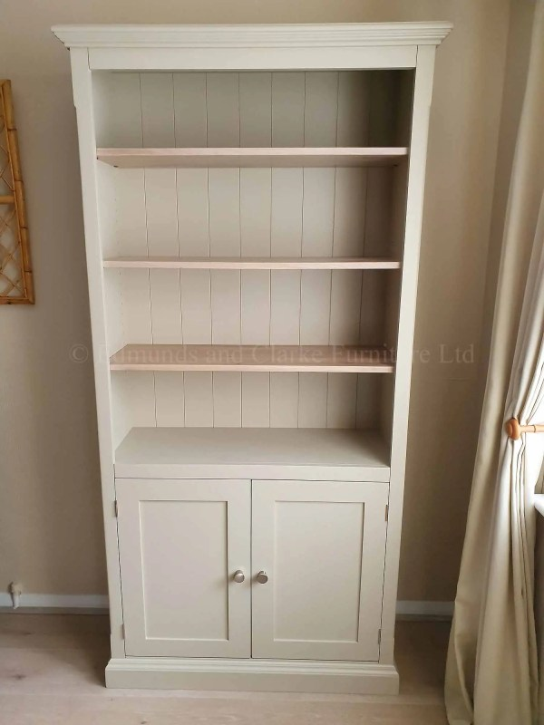 2 door bookcase painted grey with white wash lacquered oak shelves