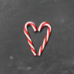 Two candy canes that are in a heart shape
