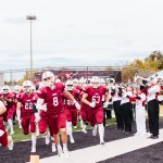 The SNU Football team running out onto the field
