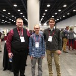 Jackson, Phillip, and Dr. Hoekman at the conference
