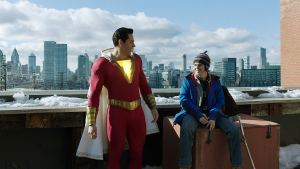 Shazam and his younger self on top of a building