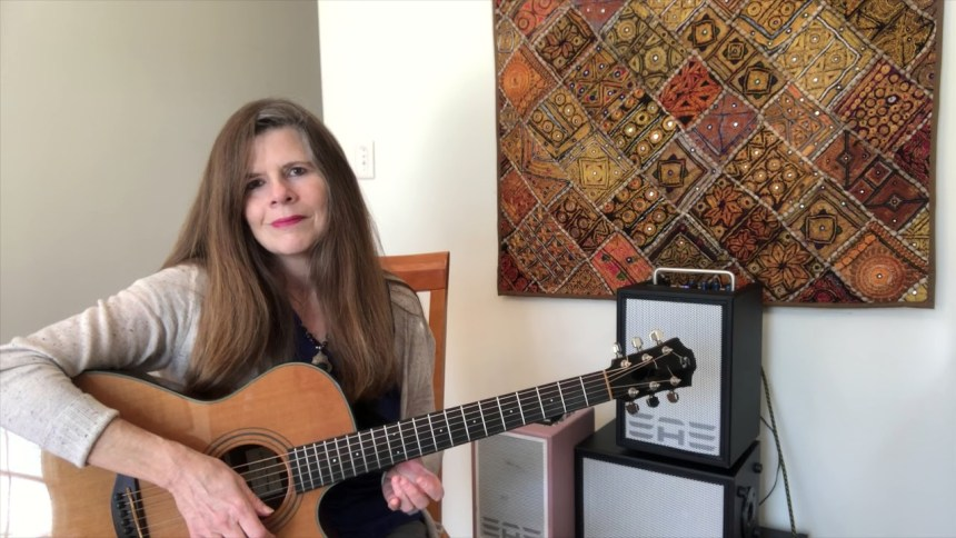 Michelle Qureshi with Guitar