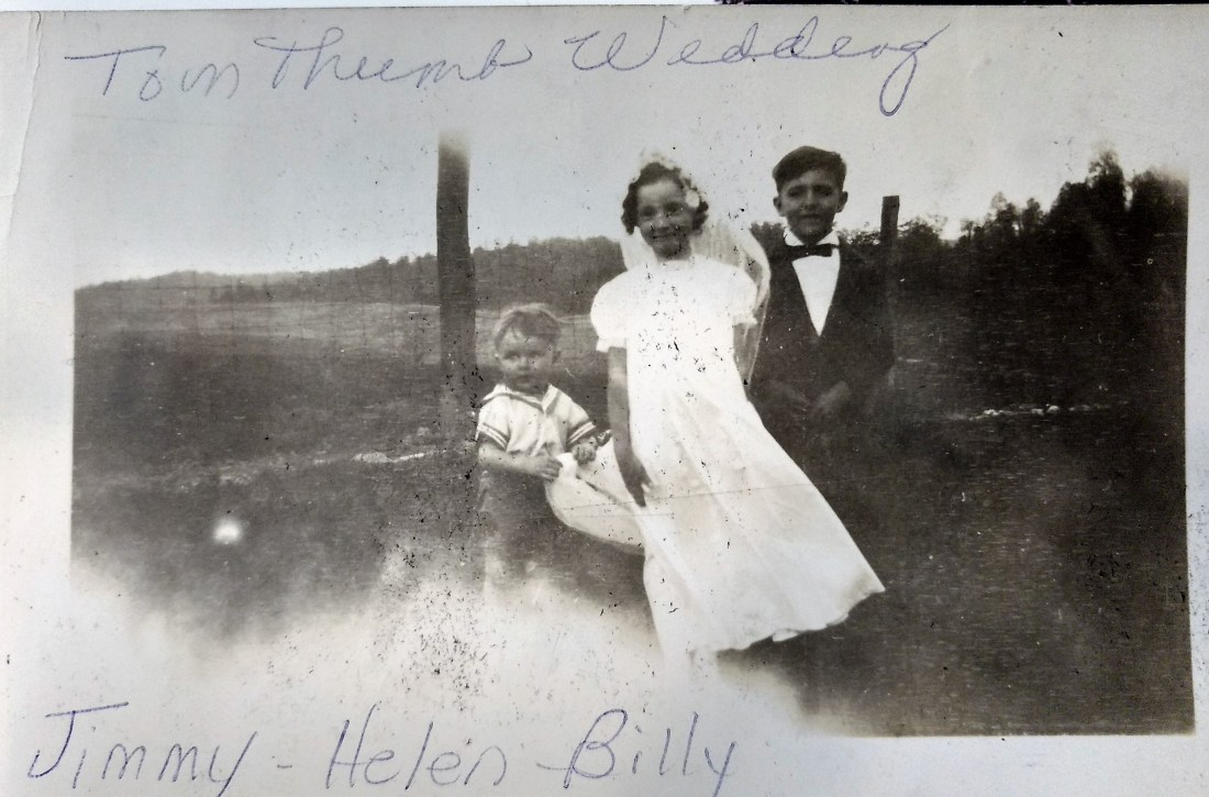 Helen, Billy Garman and Jimmy Garman carrying the train