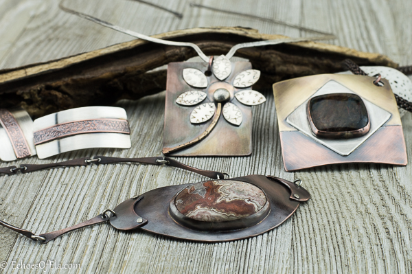 picture showing silver and copper earrings, stone and copper necklace, mixed metal rectangular flower pendant, mixed metal square pendant featuring square pietersite