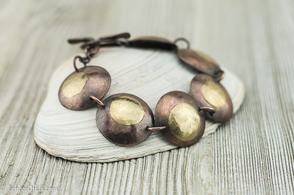 image of patina copper and brass buckeye bracelet in married metal technique