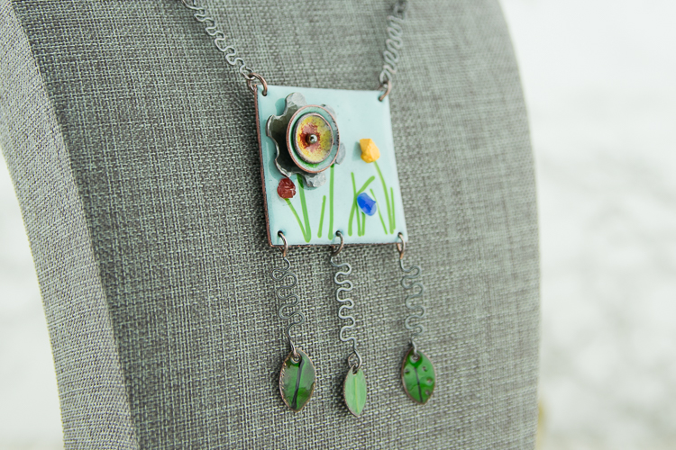 Square enameled floral pendant with leaf dangles on a hand crafted copper chain