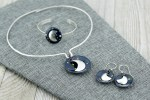 Collection of dark enamel with embedded stars and sterling silver moons