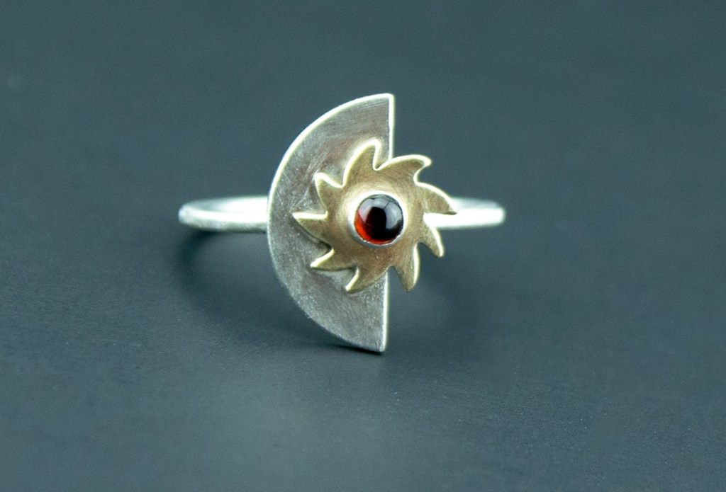 half moon sunburst celestial ring with garnet