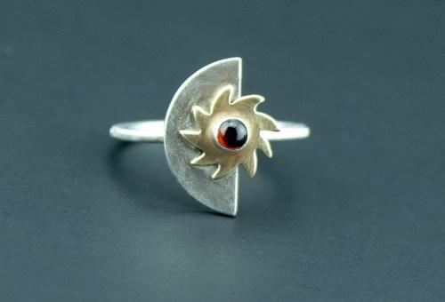 half moon sunburst celestial ring with garnet