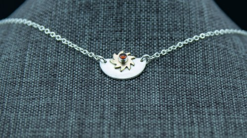 moon and sun garnet celestial necklace in sterling silver and brass