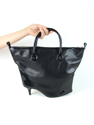 it's a brogue-zip-heel-tote-bag by  AZUMI AND DAVID