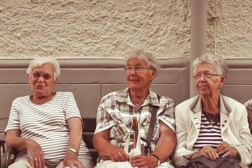 ladies sitting on a bench