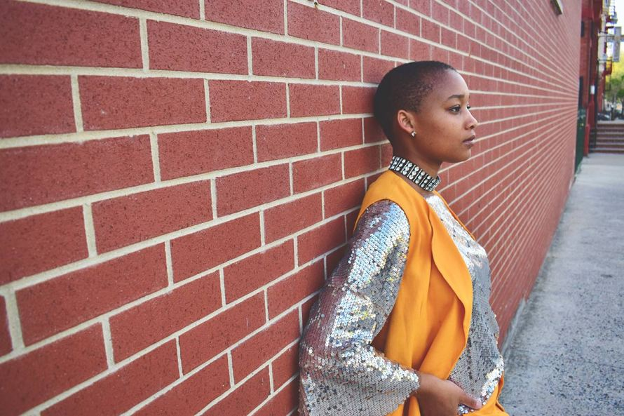 orange suit from zara with sequin shirt nia groce nia g
