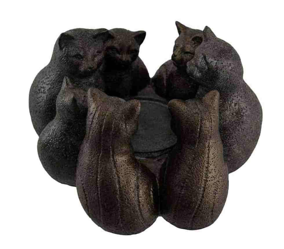 A coven of cat witches candle holder