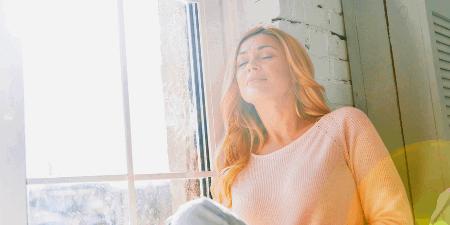 A woman in meditative prayer, using affirmations to improve her magickal power