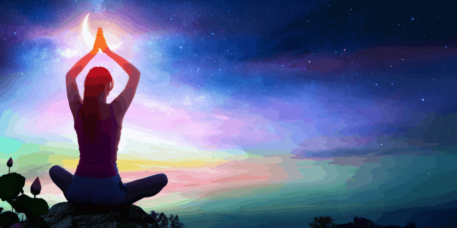 A woman meditating in front of a gorgeous night sky