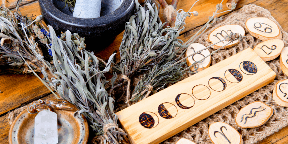 Astrology runes and pagan decorations on a wooden table
