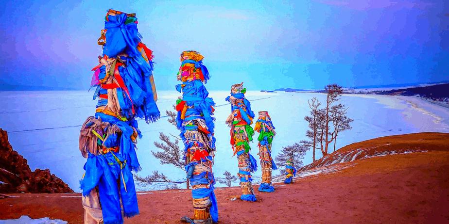 Shamanistic poles on a winter landscape