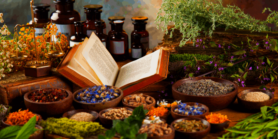 Herbs, bottles, and a book for magical spell working
