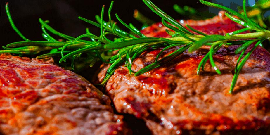 Steaks seasoned with rosemary