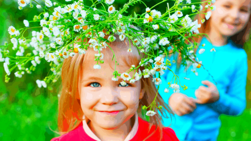 Decorative image of a child wearing a flower crown to celebrate midsummer