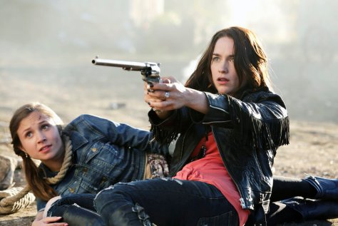 "WYNONNA EARP -- ""Purgatory"" Episode 101 -- Pictured: (l-r) Dominique Provost-Chalkley as Waverly Earp, Melanie Scrofano as Wynonna Earp -- (Photo by: Michelle Faye/Syfy/Wynonna Earp Productions)"