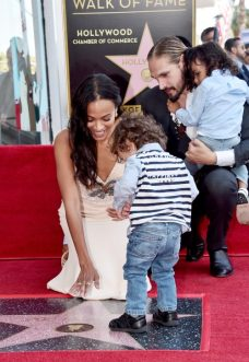 HOLLYWOOD, CA - MAY 03: (L-R) Honoree Zoe Saldana, Marco Perego, and children at the Zoe Saldana Walk Of Fame Star Ceremony on May 3, 2018 in Hollywood, California. (Photo by Alberto E. Rodriguez/Getty Images for Disney) *** Local Caption *** Zoe Saldana; Marco Perego