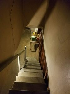 Stairs to the garage inside an estate sale home.