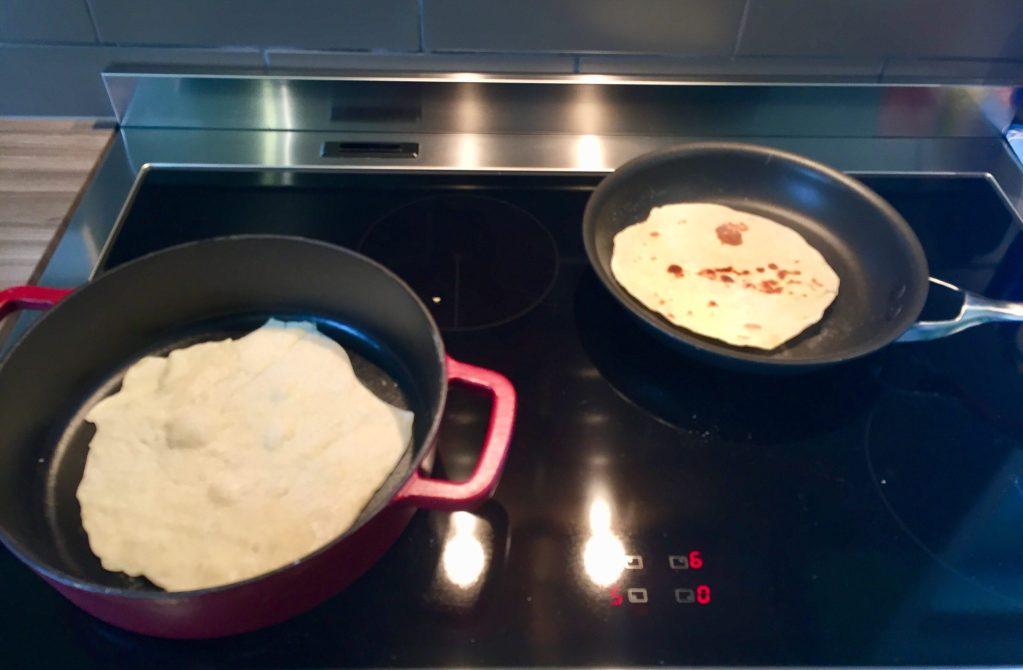 Tortillas cooking in pans